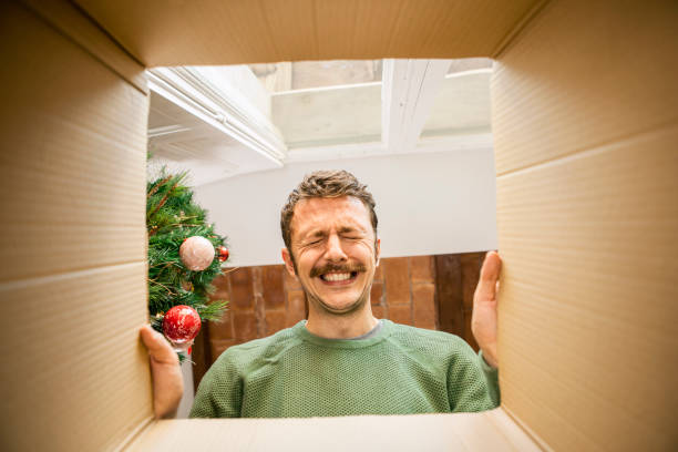 Man opening Christmas present stock photo