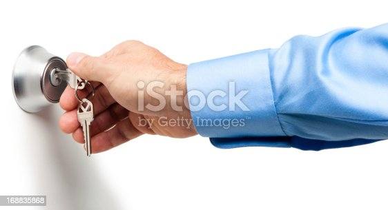 Man Opening Deadbolt Lock with Keys Isolated on White Background