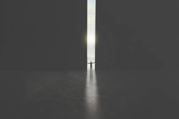 man opening huge gate to reach freedom serie of images representing a business man in silhouette walking trough different shaped door in concrete wall hope concept stock pictures, royalty-free photos & images