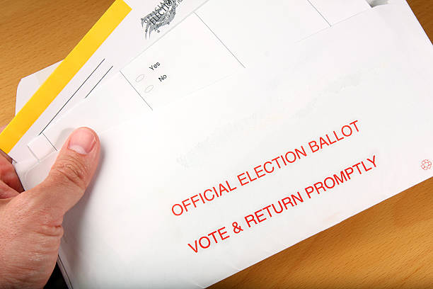 man opening mail in ballot - mail stock photos and pictures