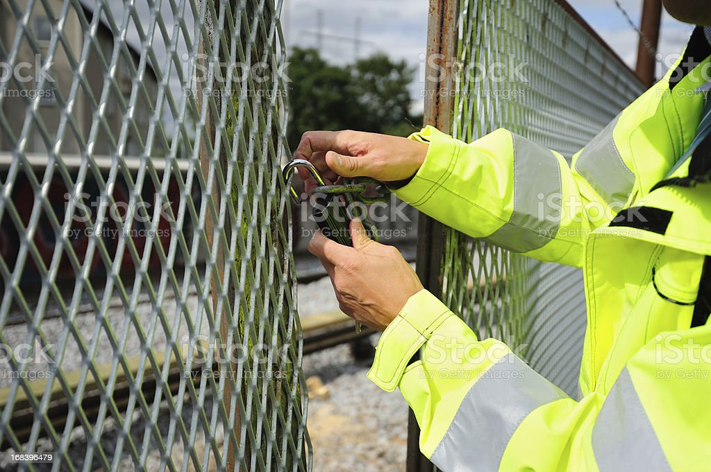 Man opening padlock stock photo