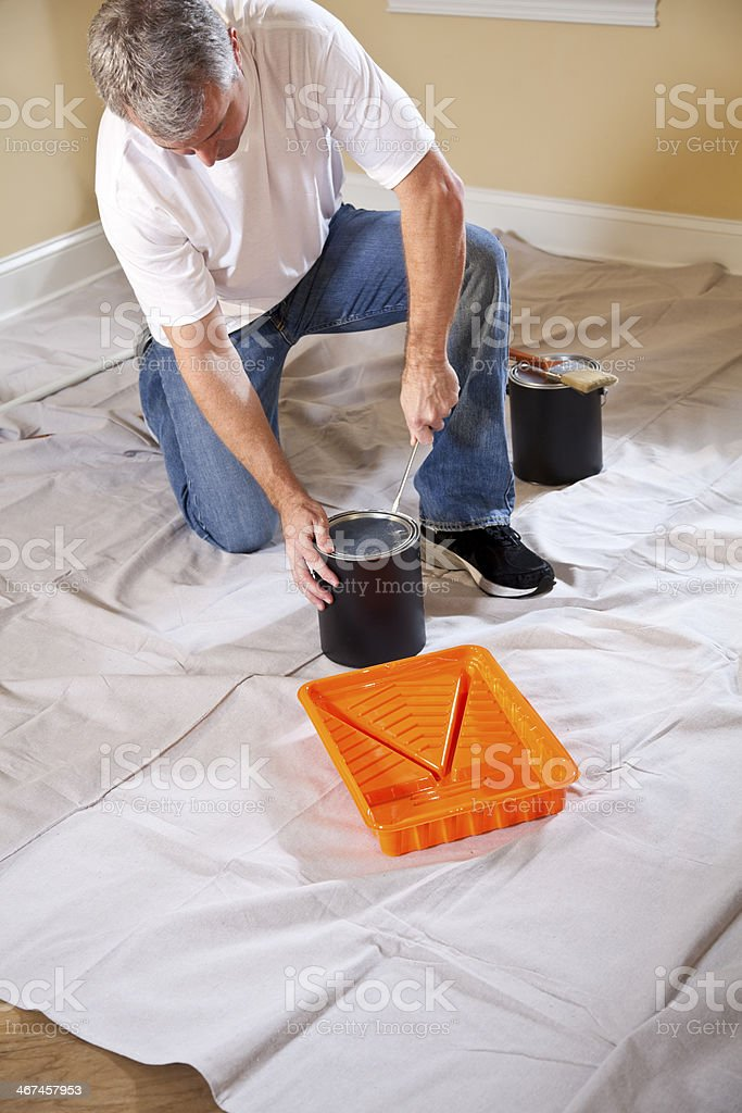 Man opening paint can stock photo