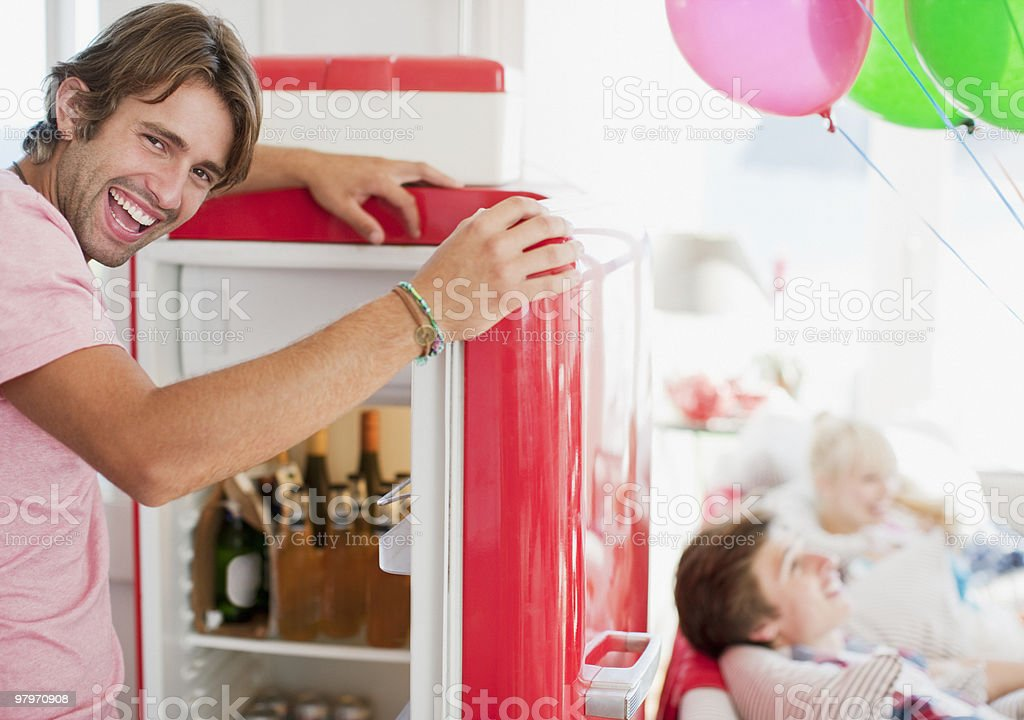 Man opening refrigerator royalty-free stock photo