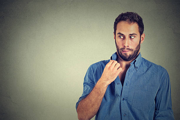 man opening shirt to vent hot unpleasant awkward situation stock photo