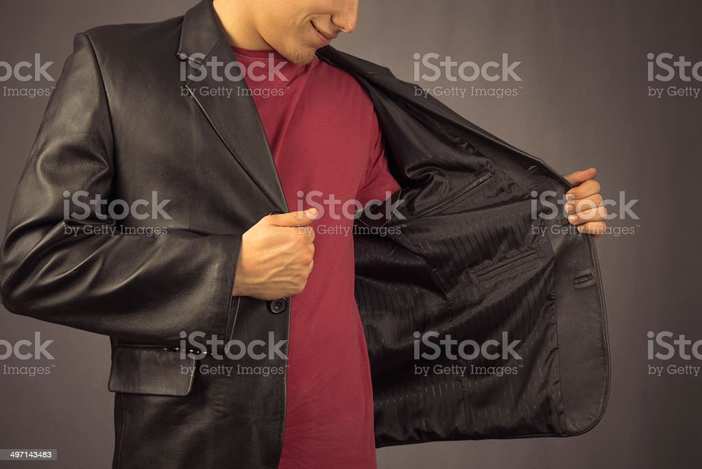 Man opens his jacket stock photo