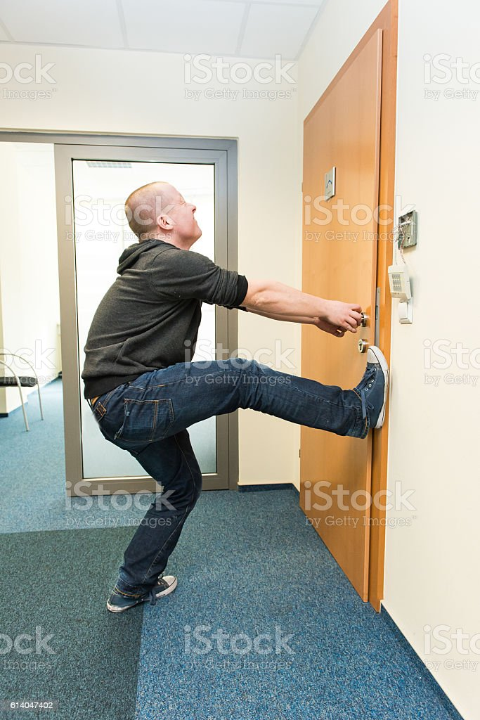 man opens the door force stock photo