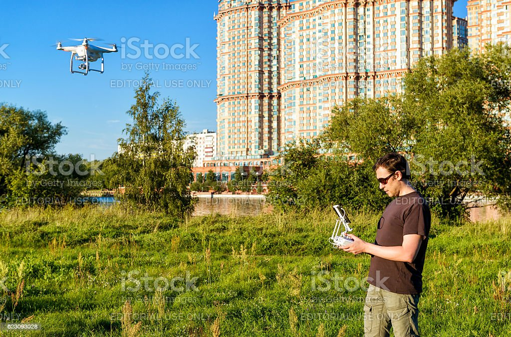 Man operating a drone quad copter stock photo