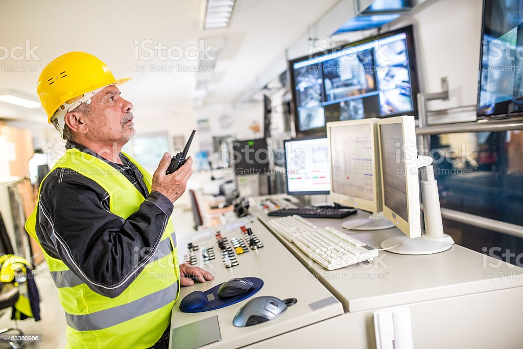 Man operating walkie-talkie at recycling plant stock photo