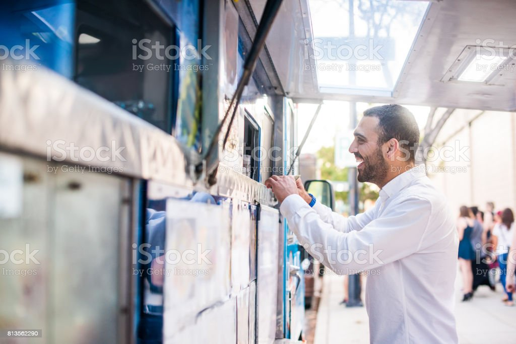 Man Ordering at the Food Truck Window stock photo