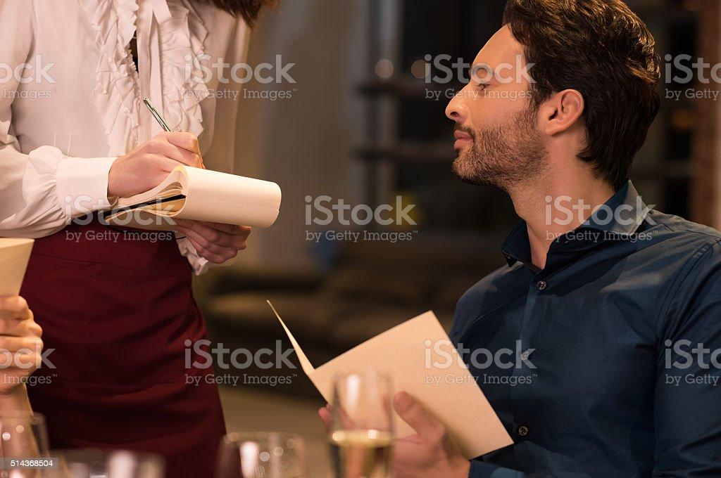 Man ordering food stock photo