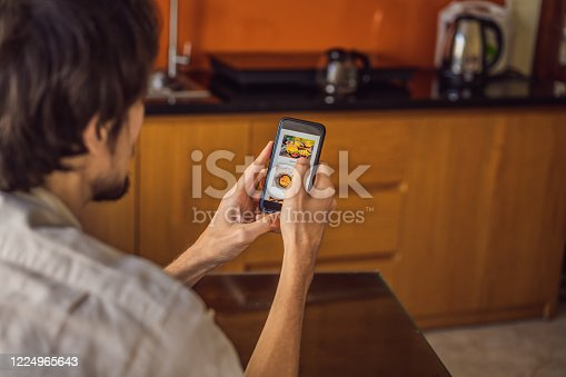 man orders food for lunch online using smartphone.