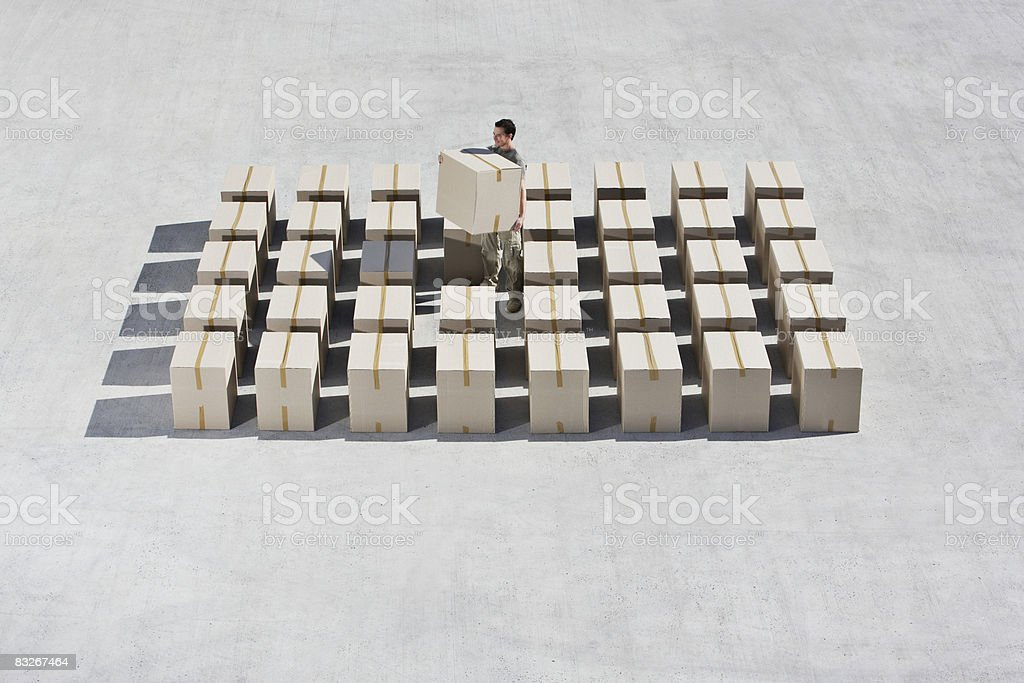 Man organizing boxes on sidewalk royalty-free stock photo