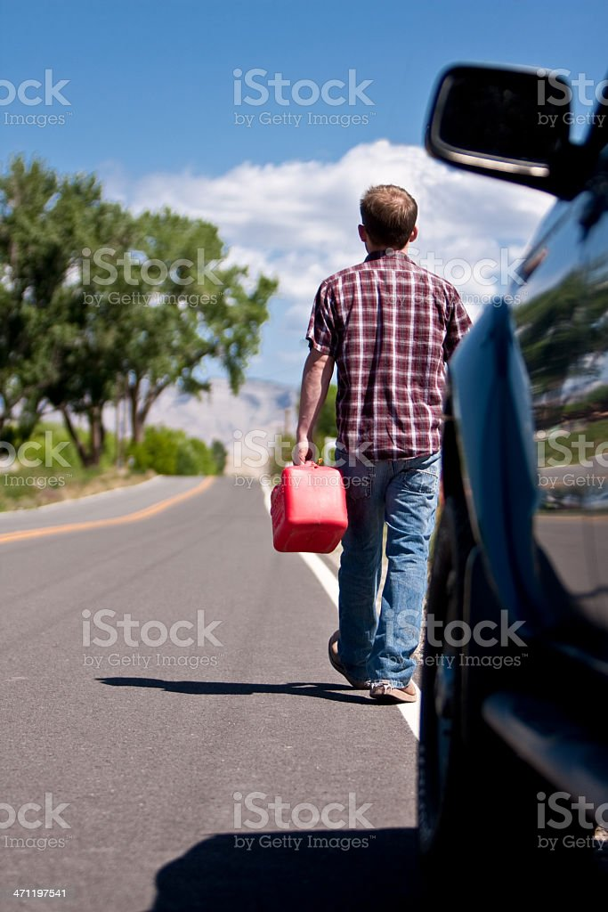 Man Out of Gas Walking with Can royalty-free stock photo