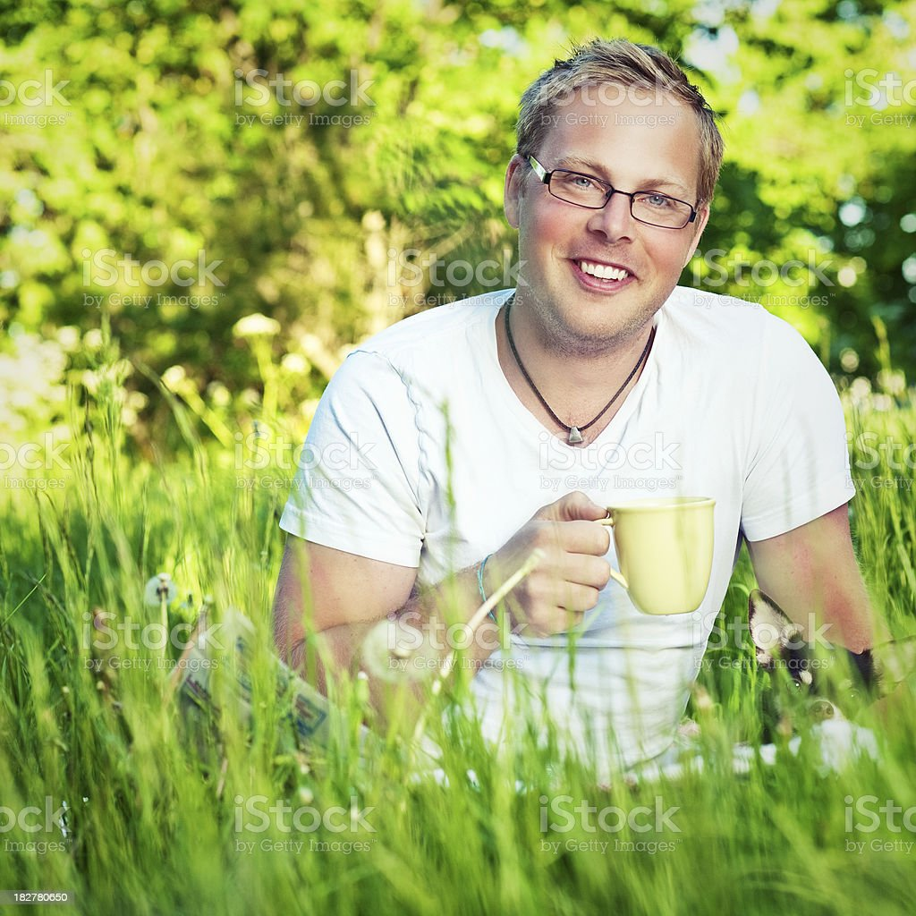 Man outdoors enjoying a cup of coffee royalty-free stock photo