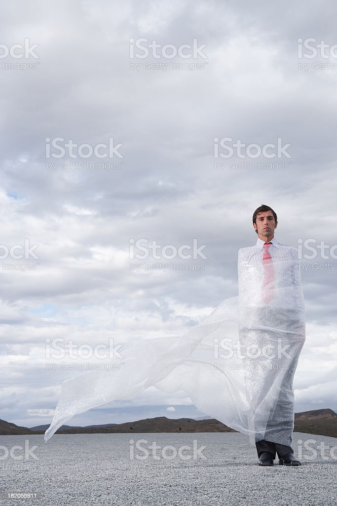 Man outdoors ensnared in a sheer sheet stock photo