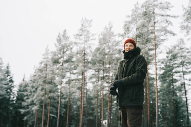 Man outdoors on cold frosty winters day stock photo