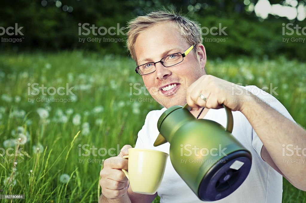Man outdoors with thermos and coffee royalty-free stock photo