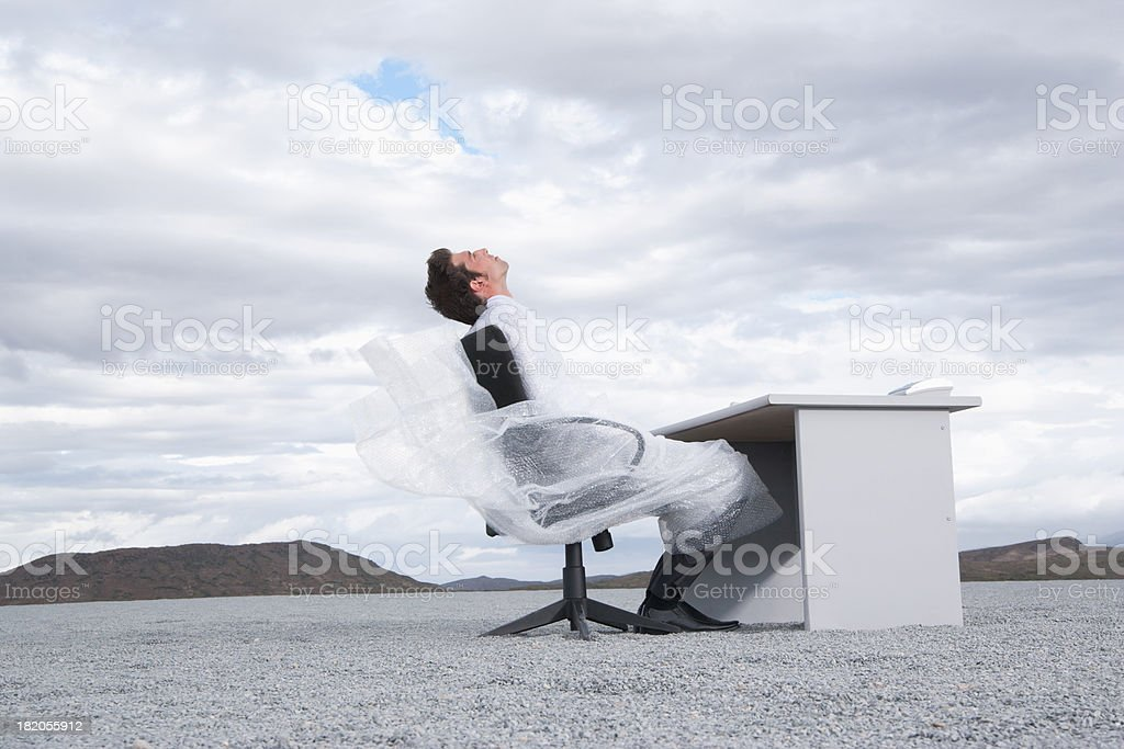 Man outdoors wrapped in a sheer sheet stock photo