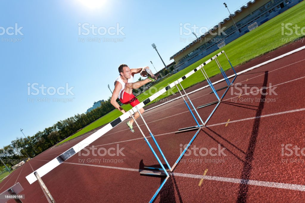 man over hurdle royalty-free stock photo
