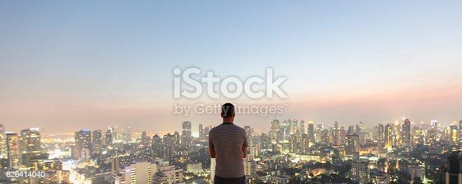Man alone over top skyscraper