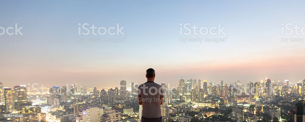 Man over top skyscraper stock photo