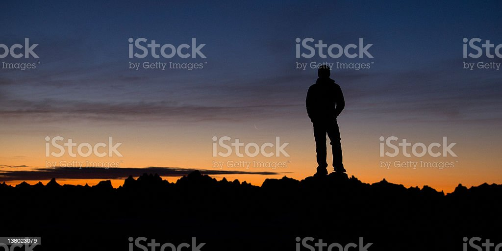 Man overlooking sunrise over mountains stock photo