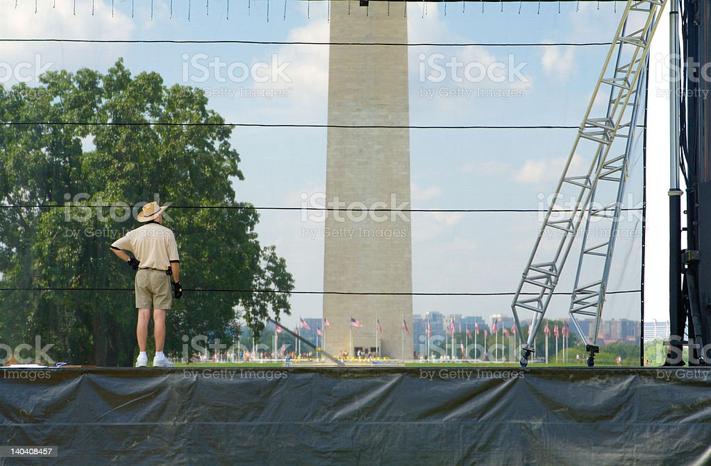 Man Overseeing Assembly of Temporary Stage on National Mall royalty-free stock photo