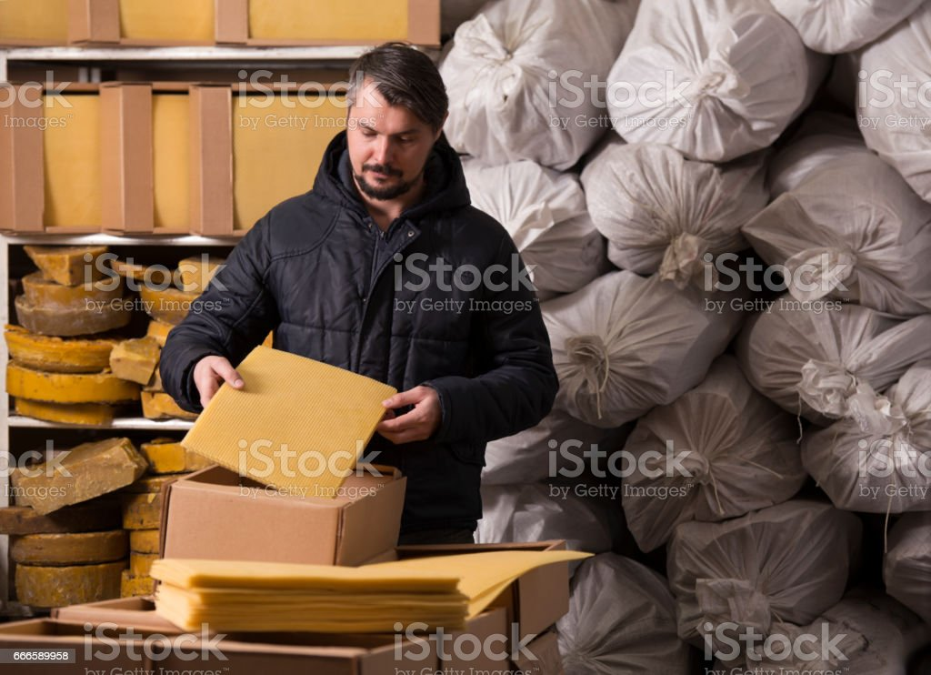 Man packing honeycomb sheets. stock photo