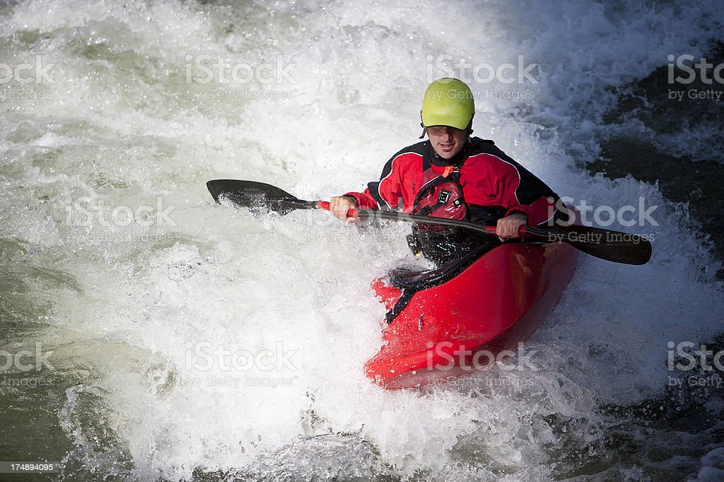 Man whitewater kayaking on a Montana river.