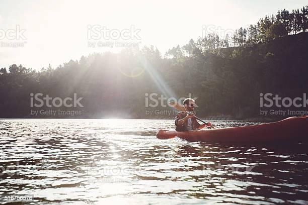 Man Paddling Kayak On A Summer Day Stock Photo - Download Image Now