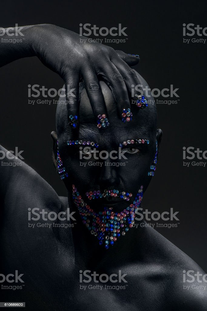 Man painted in black color with rhinestones beard and eyebrows - foto de acervo