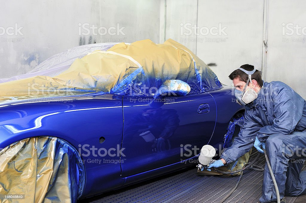 Man painting a car. stock photo
