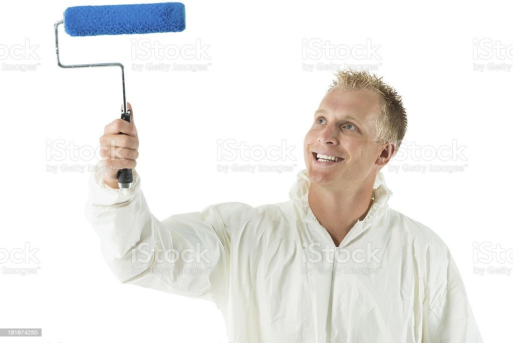 Man painting a wall with paint roller royalty-free stock photo