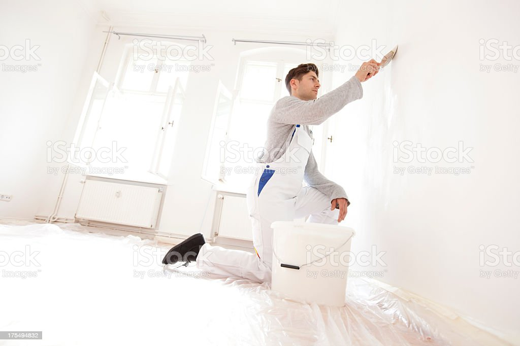 Man painting an appartment stock photo