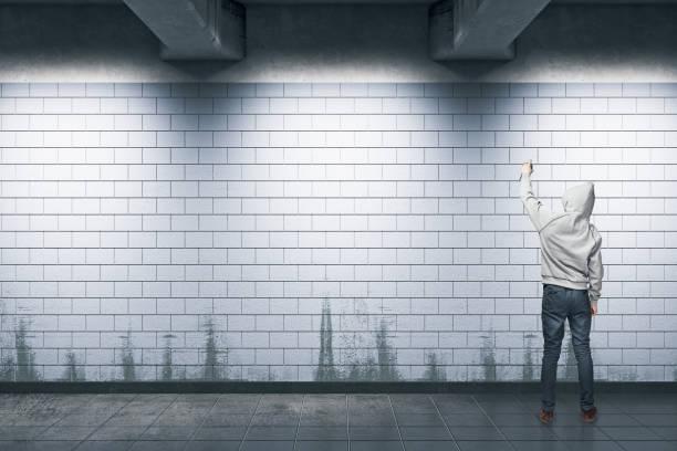 Man painting graffiti stock photo