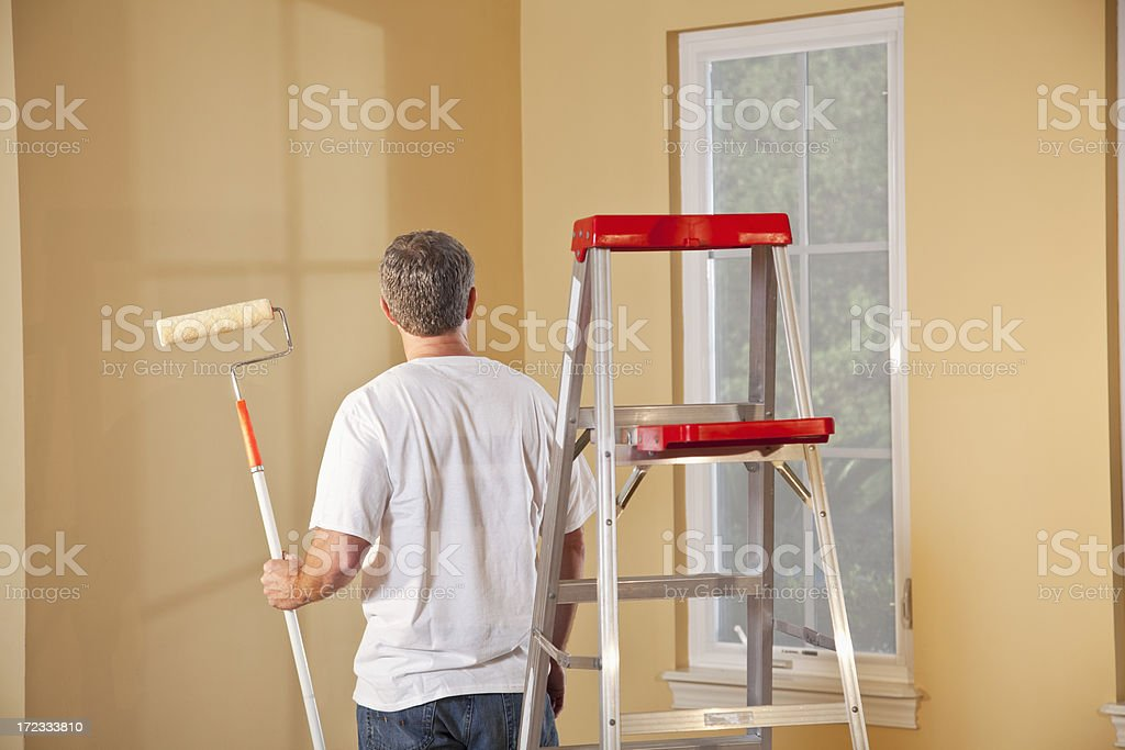 Man painting home interior stock photo