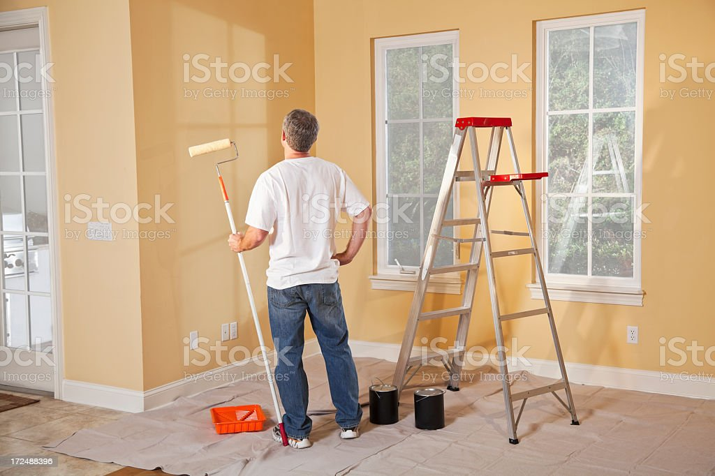Man painting home interior stock photo