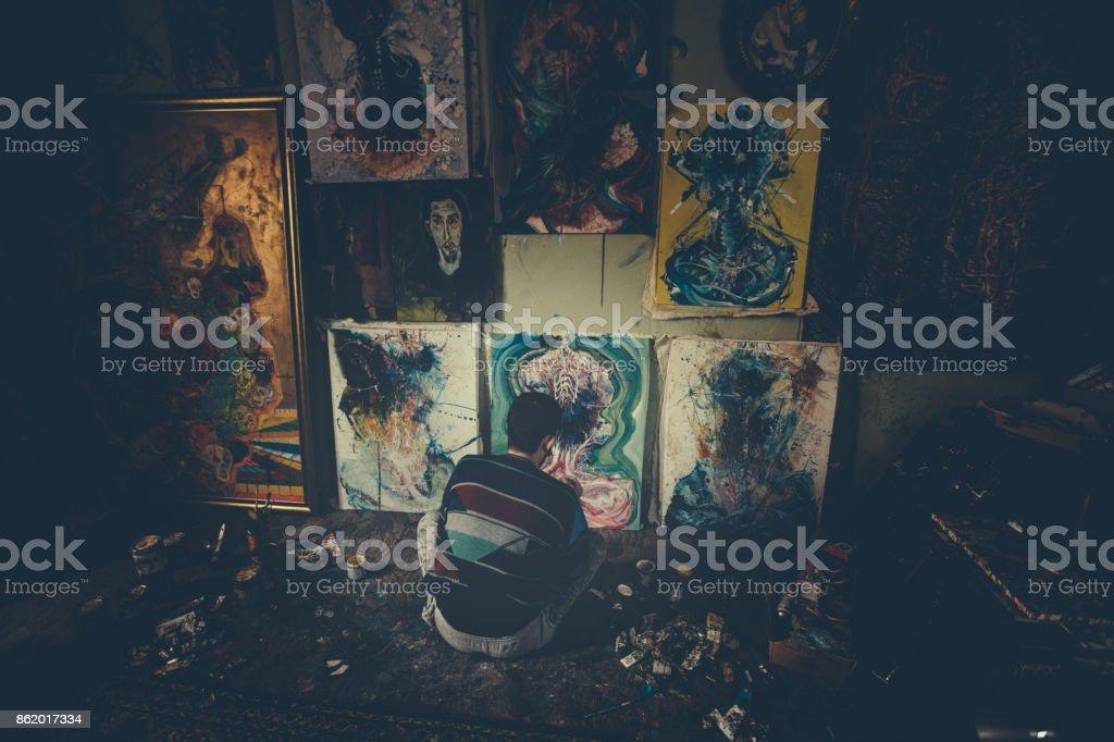 Man painting in studio stock photo