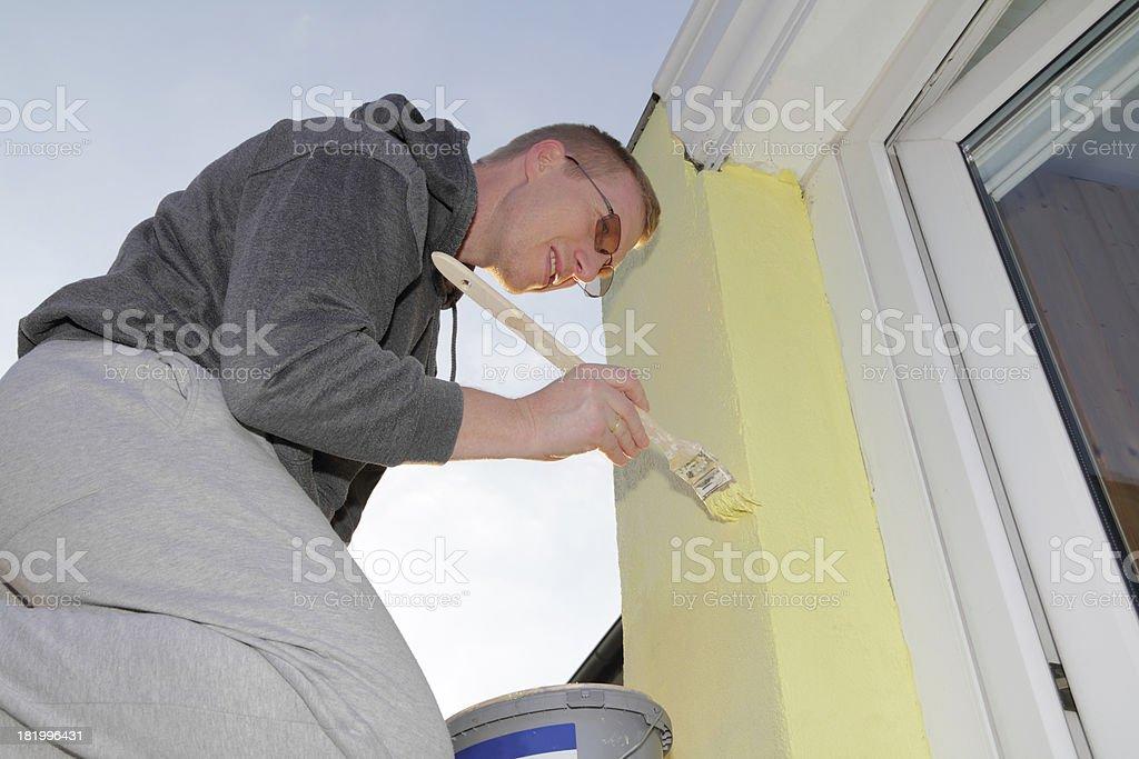 man painting stock photo