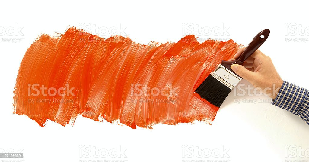 Man painting red paint on white wall royalty-free stock photo