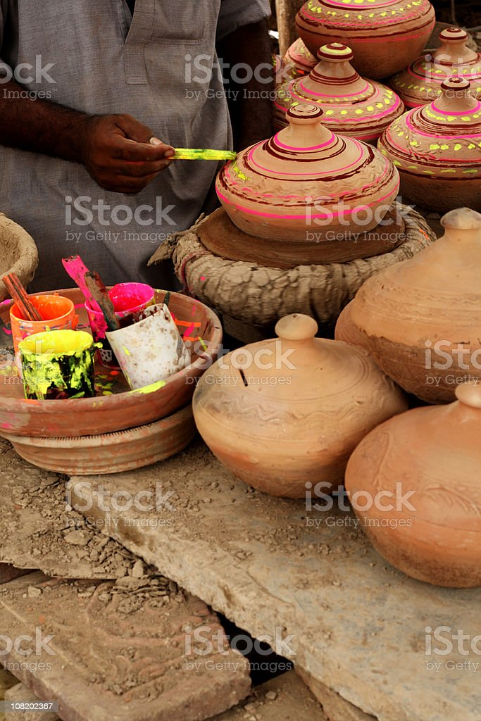 Man Painting Terracotta Pots Bright Colors royalty-free stock photo