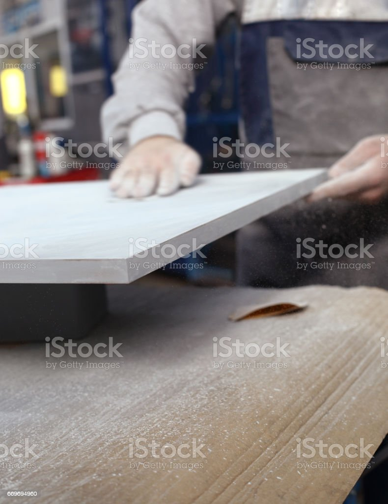 Man painting the outside of a house stock photo