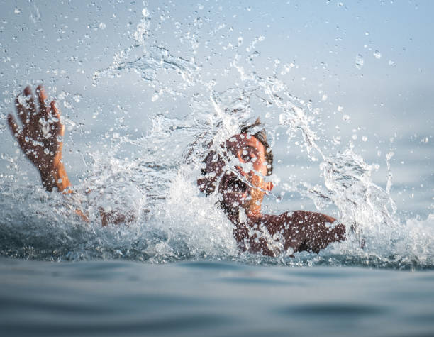 man panics and drowns - swim arms imagens e fotografias de stock