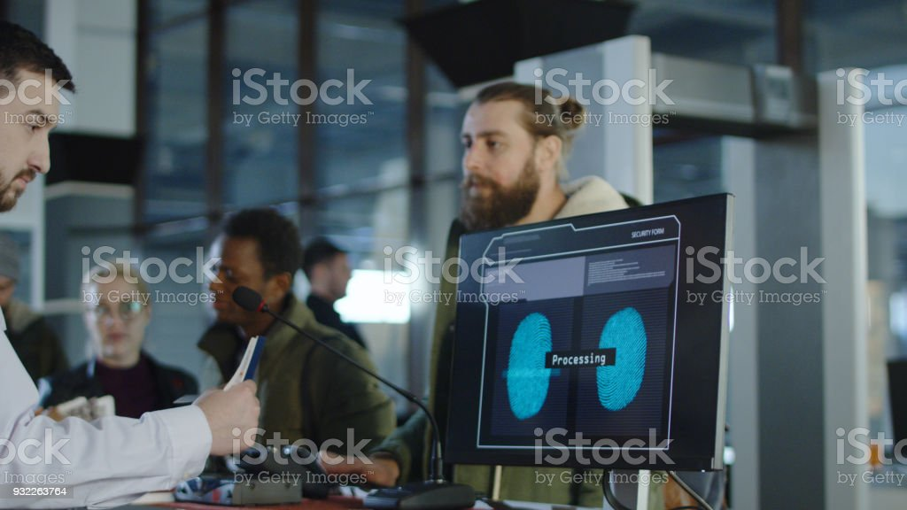 Man passing biometric control at counter stock photo