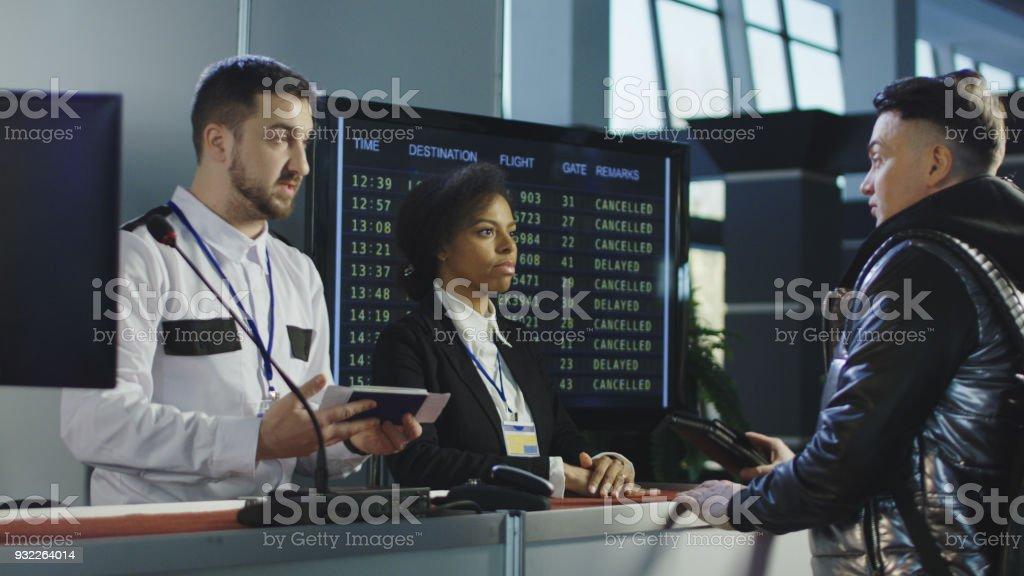 Man passing biometric control at counter stock photo