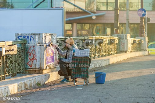 istock Man pasting a poster on a bridge 507842760