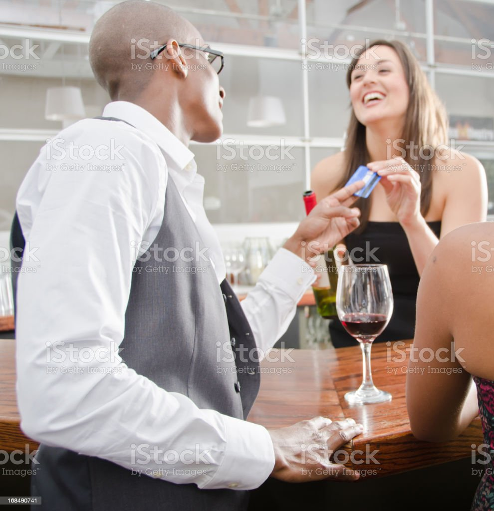 Man Paying Bartender With His Credit Card royalty-free stock photo