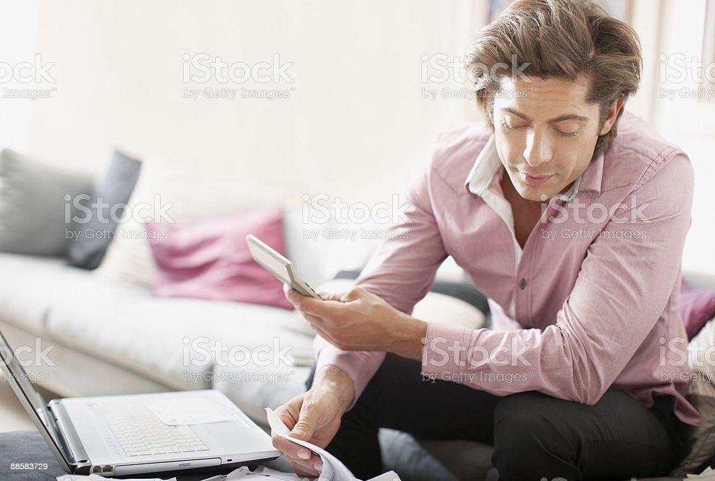 Man paying bills at home royalty-free stock photo