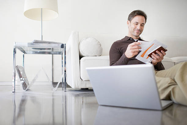 man paying bills at home - mail stock photos and pictures