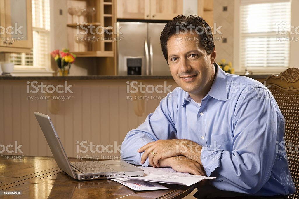 Man paying bills on computer. royalty-free stock photo